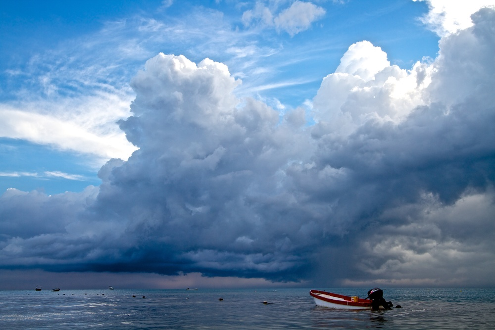 Storm clouds hover threateningly over a lonely boat.  Canon EOS 7D EF-S 10-22mm at 22mm f/10 1/100 ISO 100 −1ev