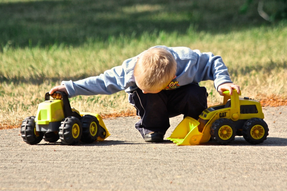 A little boy deep in a world of play with his tractors. Canon EOS XSi EF-S 70-300mm at 200mm f/5 1/800 ISO 200