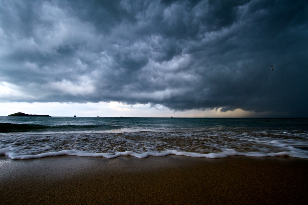 Angry, low hanging clouds, hang over the water.  Canon EOS 7D EF-S 10-22mm at 12mm f/7.1 1/80 ISO 100