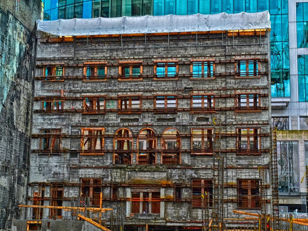 Preserving an old wall amongst the steel and glass of a growing city. Fuji X10 at 16mm f/11 1/220 ISO 400 −1ev