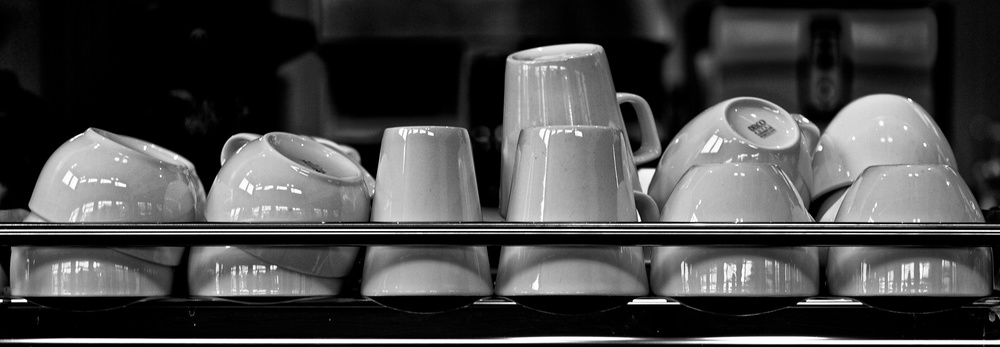 Mugs stacked in the coffee shop ready to go.  Canon EOS 7D EF 50mm at f/2.5 1/50 ISO 100