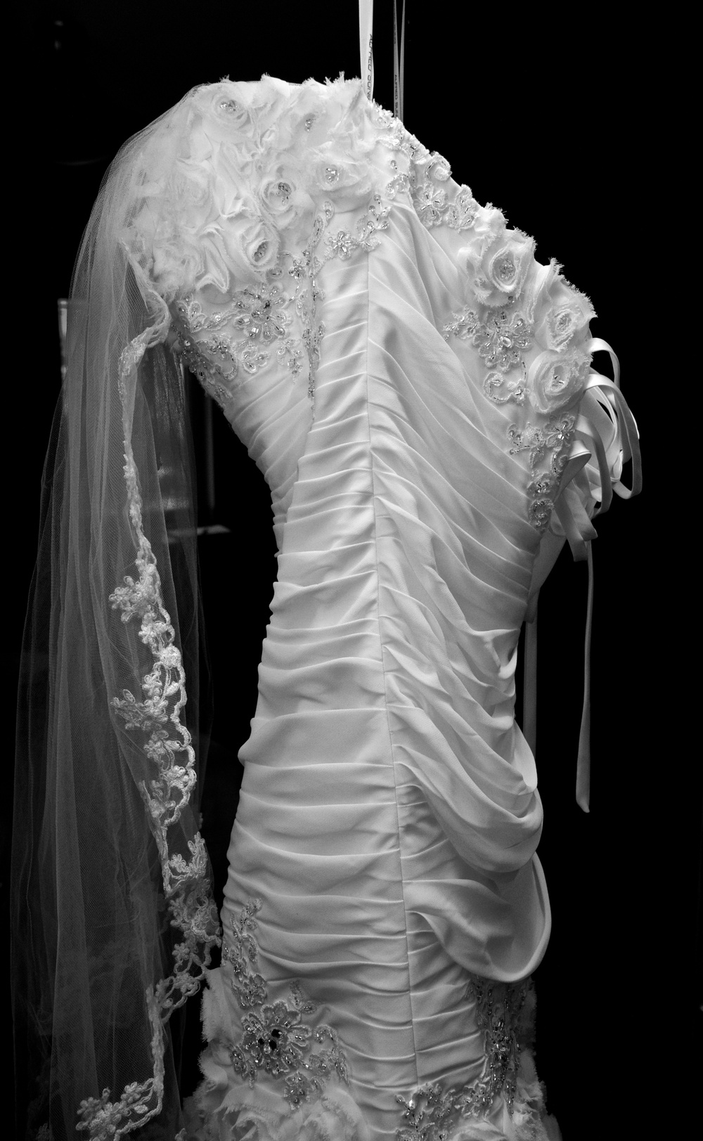 The Dress hangs ghostly, waiting to be animated.  Canon EOS 7D EF-S 17-55mm at 17mm f/4.5 1/60 ISO 800.  Flash bounced off the ceiling at -.667 ev