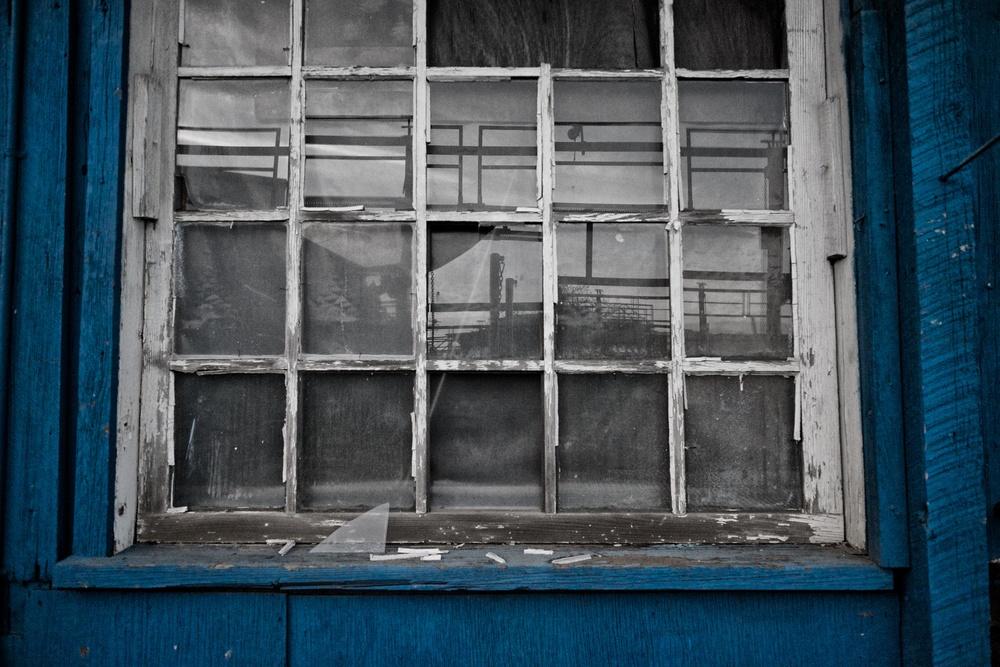 Reflections in a broken shipyard window. Fuji X-E2 XF14mm 2.8 at f/2.8 1/2500 ISO 6400