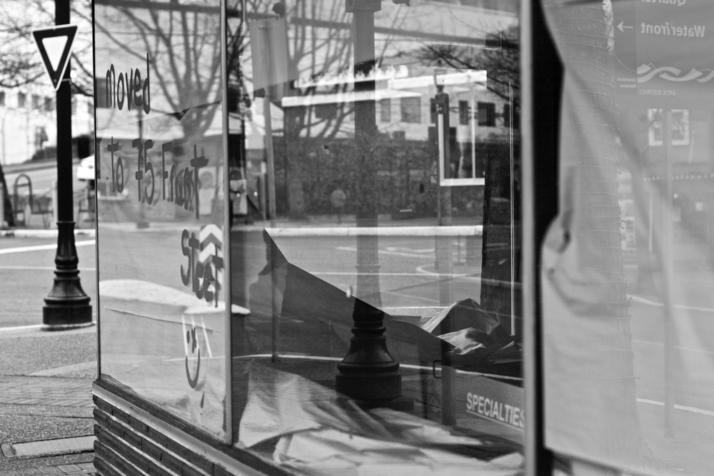 Reflections in the the glass layer the street. Canon EOS 7D Mk. II EF 50mm f/1.4 at f/2.8 1/60 ISO 400