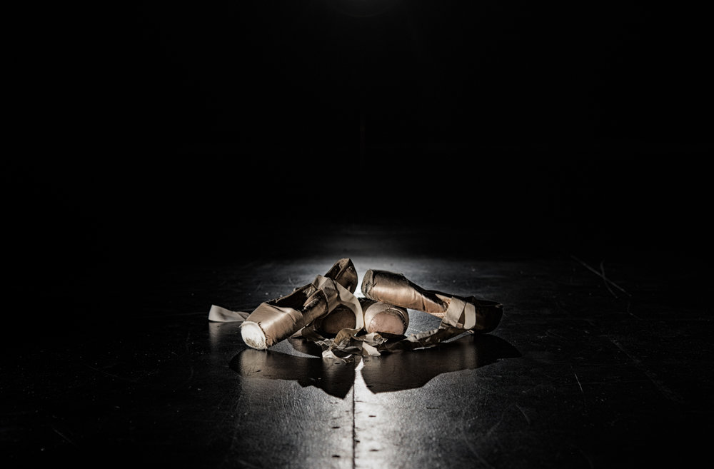 A dancer's pointe shoes in a puddle of light on the stage. Canon 7D Mk. II EF-S 17-35mm at 35mm f/3.2 1/250 ISO 400