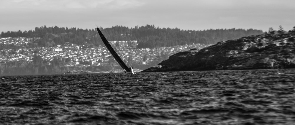 Sometimes shape and form are all you need as the sail forms a knife edge, slashing across the photograph connecting see to sky.