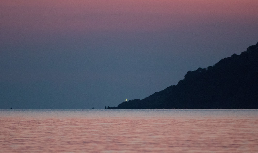 Two Greek fishermen at work in the evening off Korakas.  The rocks that are visible are not even the most dangerous ones.  There are several treacherous rocks just below the surface of the water right in front of the light house.  These are the ones that have done so much damage.