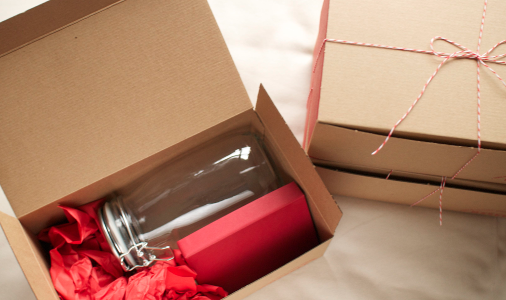 The glass jar (purchased from West Elm Market) and box of paper all ready to give. Red twine and kraft - a classic combination.