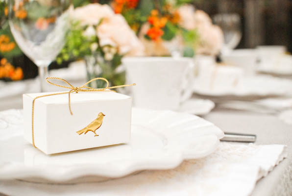 This little gold bird is made by using a craft punch and placing a piece of gold candy wrapper inside the box.