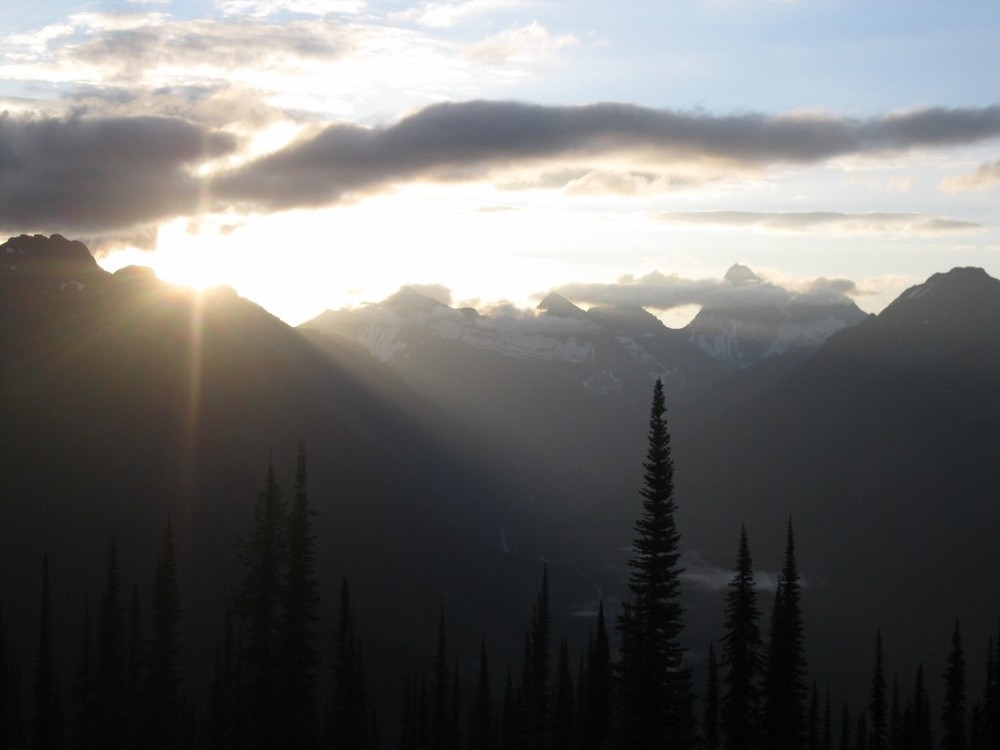 Early morning sunrise on the roof of the Mt Fidelity Research station looking over Rogers Pass below.