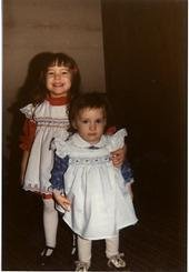 My sister and little me upset that I had to wear a dress and stockings.