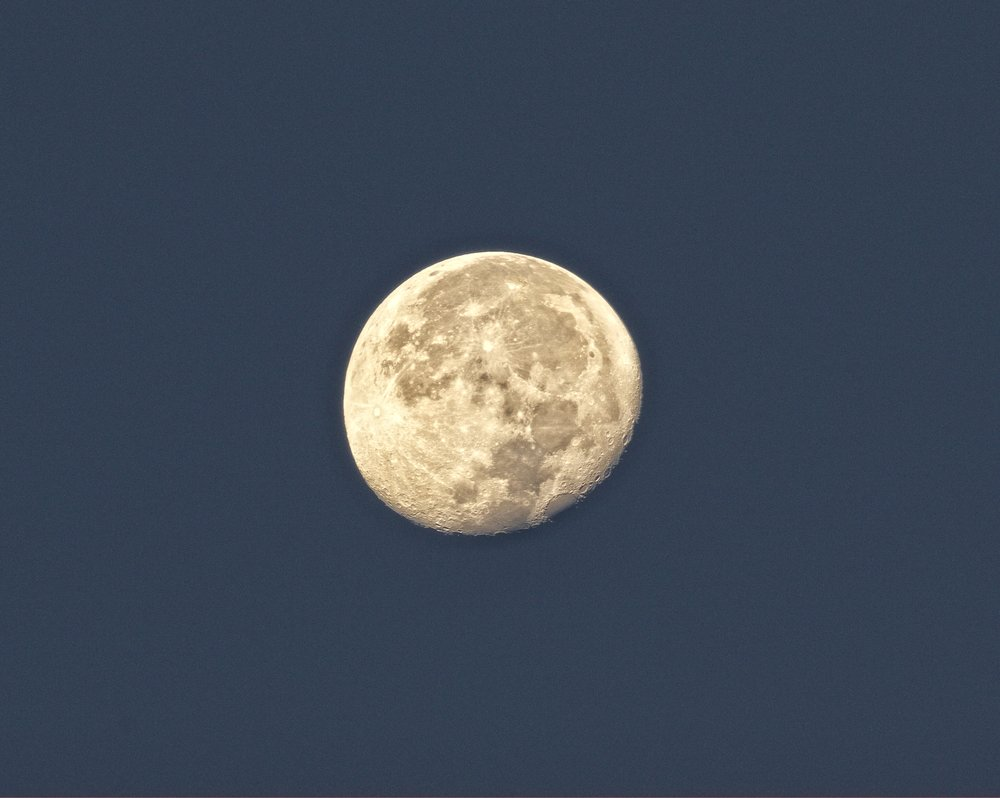 A waning gibbous moon sets over the Broward in the Western sky.