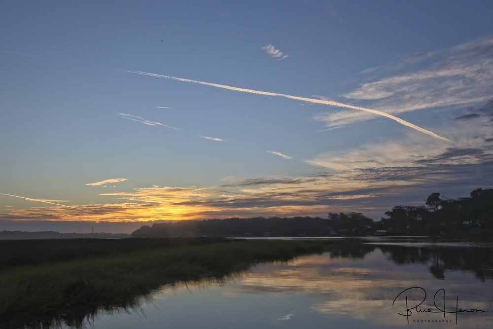 Contrails of hope stretch across the predawn sky…