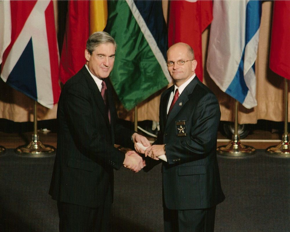 FBI Director, Robert Mueller, presenting Frank with his certificate from the National Academy.