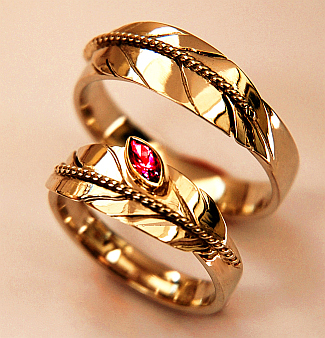 "SHKODE-WAABIGONII GIKINAWAAJINOWAAN N'ZAAGIWEWIN - ""A Flower of Fire Symbolizes Our Love"" - Zhaawano Giizhik Wedding rings of 14K yellow gold, the ladies' ring is mounted with marquise-cut ruby. For additional information about these wedding rings, see:http://www.unieketrouwringen.nl/trouwringen/liefde/vuurbloem"