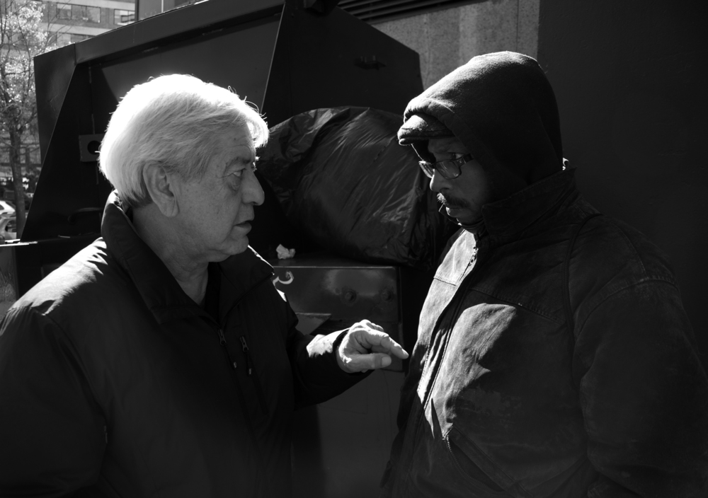 Dr. Anthony Martinez asks a homeless man about his health in front of the Cathedral of St. Matthew the Apostle on Rhode Island Avenue. The man sleeps in front of the church and survives on the money he makes from panhandling before and after church services.