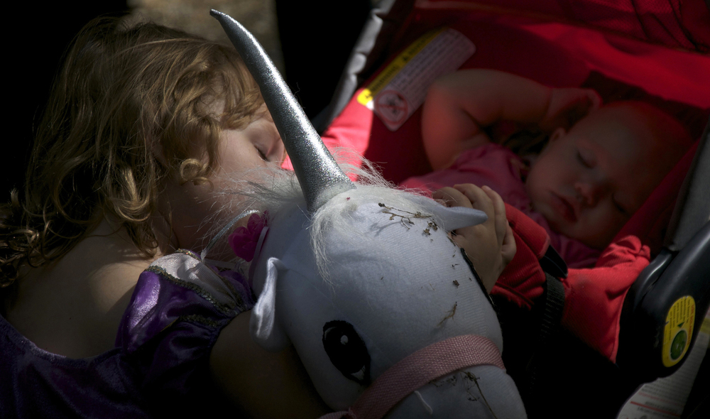 A baby and her older sister take a nap during the Maryland Renaissance Festival in Crownsville, Maryland on September 15, 2012.