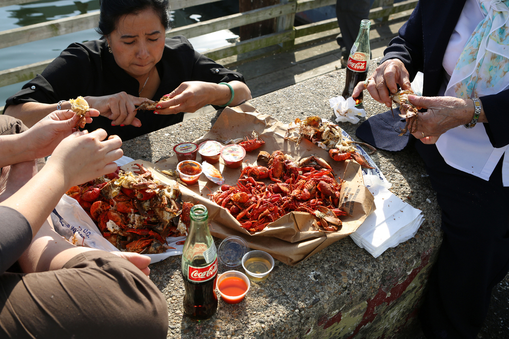 Tourists eat crabs at Washington, D.C.'s Southwest Waterfront.