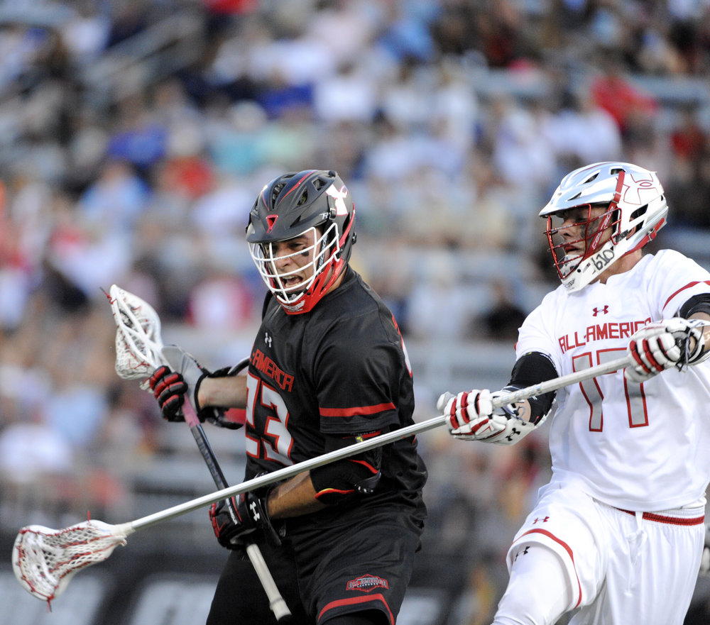 Brian Smyth, left, makes his way down the field during the Under Armour All-America Lacrosse Game, which took place on Saturday, July 2, 2016 at Towson University.