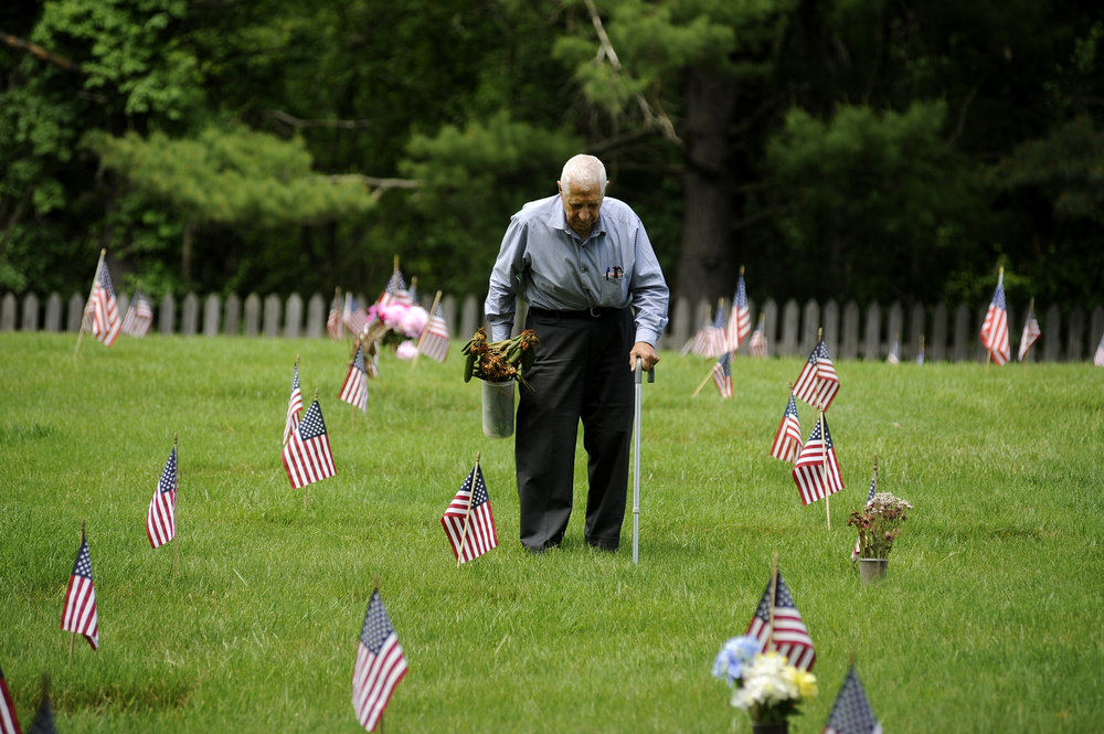 Leo Hindoyan of Towson, Maryland helps to clean up the Dulaney Valley Memorial Gardens in Timonium, Maryland during the Memorial Day ceremonies Monday, May 30, 2016.