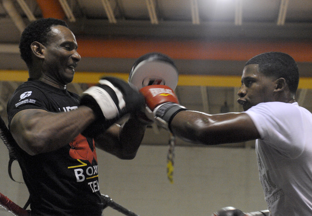 "Lorenzo ""Truck"" Simpson trains with boxing coach Calvin Ford at Upton Boxing Center in Baltimore, Maryland, August 18, 2016. Simpson won a gold medal at the Junior Olympics National Boxing Tournament in July."