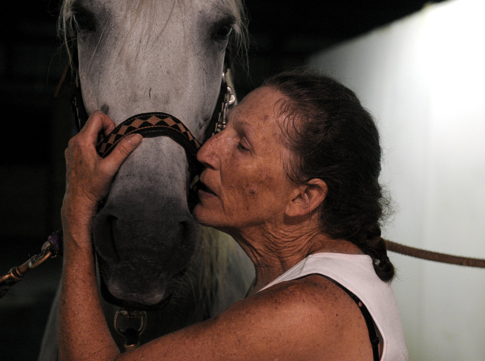 Cecelia Cress of Abingdon kisses and talks to Colada after an evening of riding at Freedom Hills Therapeutic Riding Program in Port Deposit, Maryland on Wednesday, August 17, 2016. Cress, a disabled Air Force veteran, said that horseback riding is helping rebuild her leg muscles after she shattered her knee.