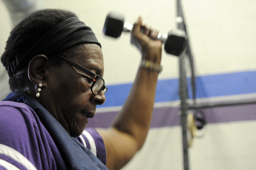 Nancy Sullivan of Woodbine, Maryland lifts a dumbbell at CrossFit RSC in Finksburg, which offers strength training exercises for the young, and older.