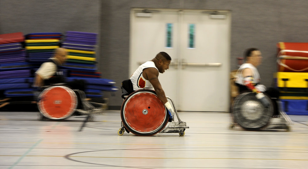 Ryan Major, an Iraq War veteran, practices drills with his wheelchair rugby team, Maryland Mayhem, on Wednesday, May 18, 2016, at Honeygo Run Regional Park in Perry Hall, Maryland.