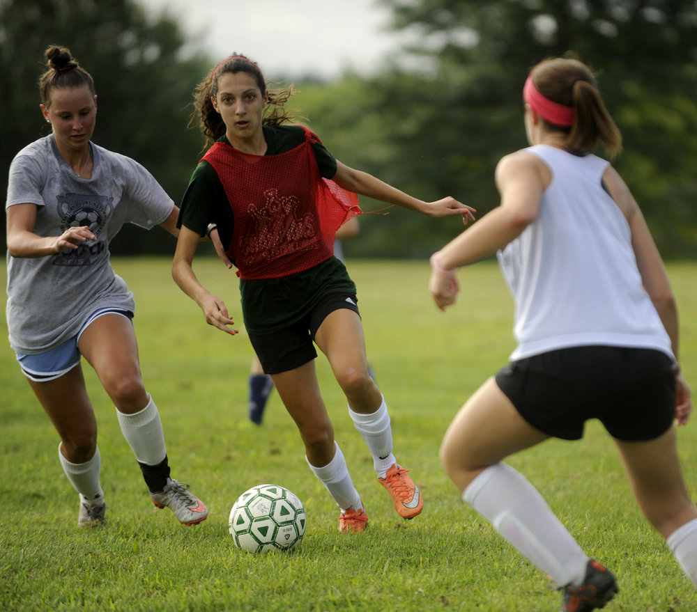 Kaylee Titus, 11th grade, moves the ball down the soccer field. The Century High School girls soccer team practices in Sykesville, Maryland Wednesday, August 10, 2016.