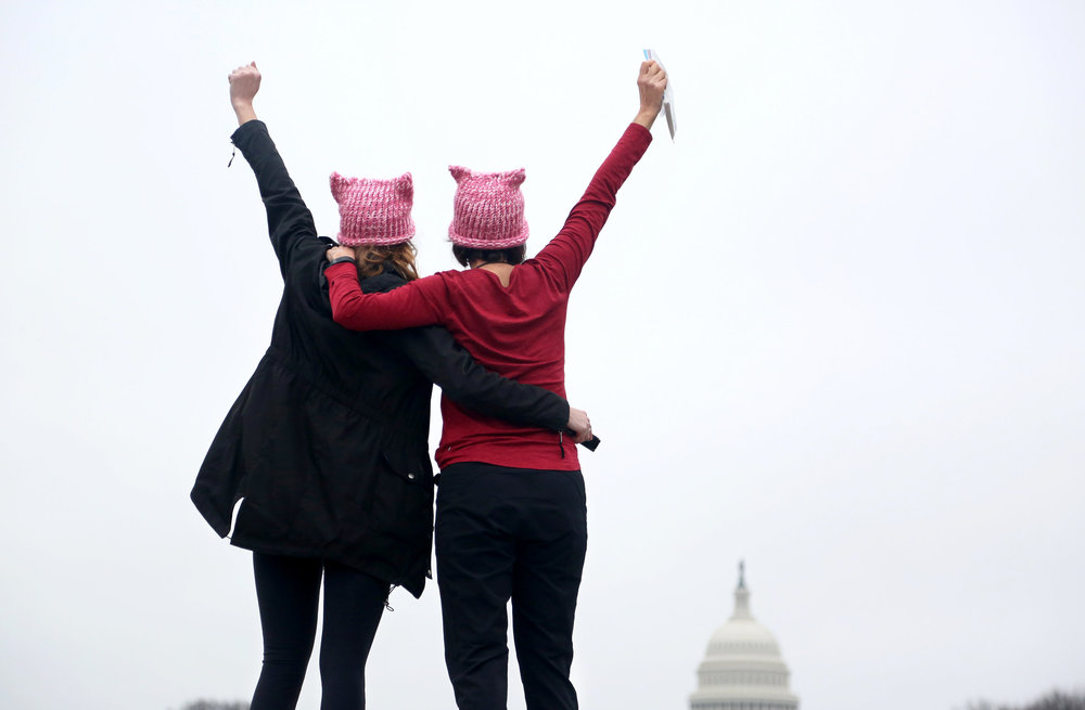 Two women face the United States Capitol Building Saturday, January 21, 2017, during the Women's March on Washington.