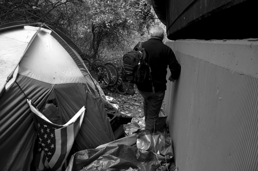 Cliff and Melanie, a homeless couple living underneath the freeway, are nowhere to be found, so Dr. Anthony Martinez continues his search for the couple. No one is in the tent and there is hardly a trace of activity.