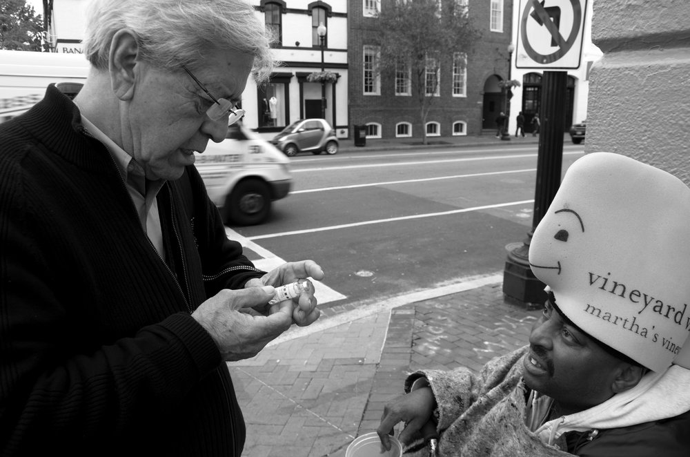 John Sullivan, a diabetic, panhandles in Georgetown on the intersection of M Street and Wisconsin Avenue. Sullivan tells Dr. Anthony Martinez his insulin is running low, and the doctor promises to bring him a new supply the next day.