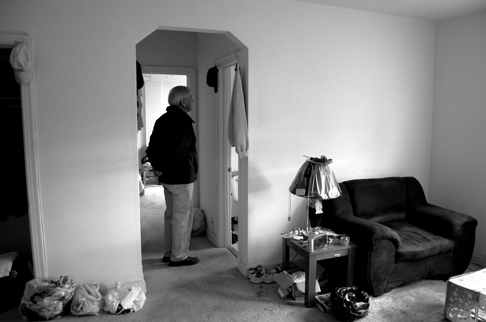 Dr. Anthony Martinez looks around Charles Bowman's apartment. Martinez helped set up the apartment for Bowman, but the alcoholic prefers to spend his time outside on a bench at Pennsylvania Avenue and 25th Street.
