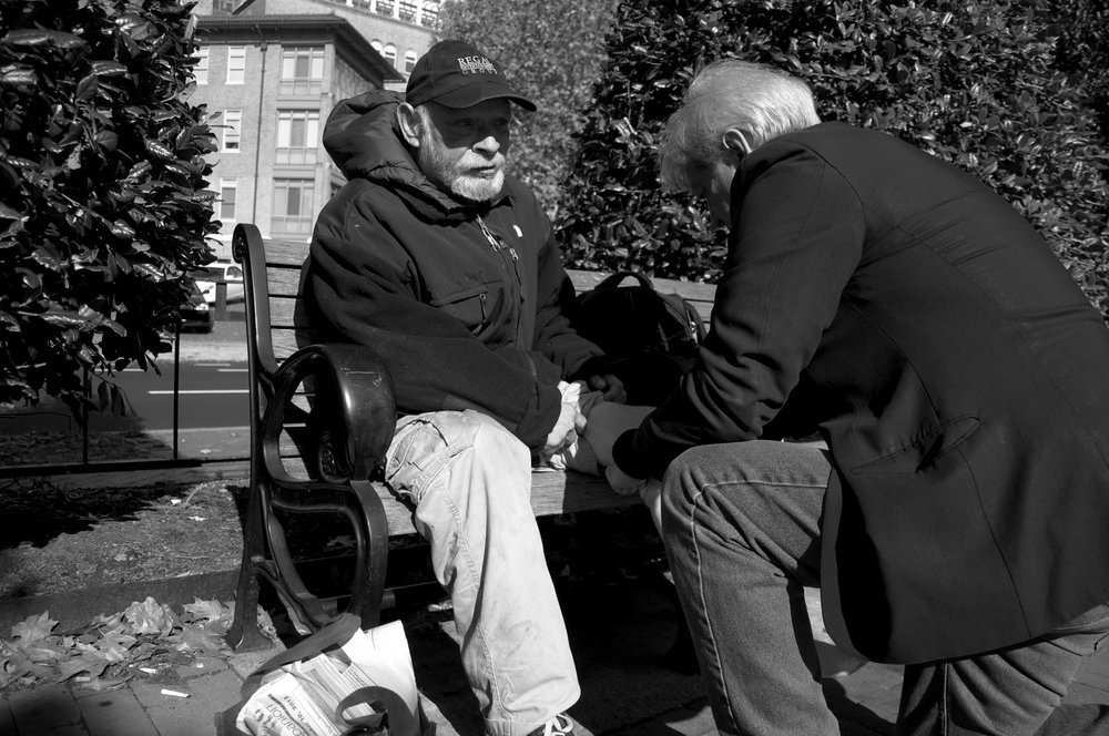 Dr. Anthony Martinez finds Charles Bowman at Pennsylvania Avenue and 25th Street. Martinez examines his leg, using his fingers to massage the tendons. He concludes the leg is sprained and a brace will help Bowman walk more steadily. In the past, a bus hit Bowman as the alcoholic stumbled drunkenly across an intersection. The hospital refused to take him because he was so inebriated.