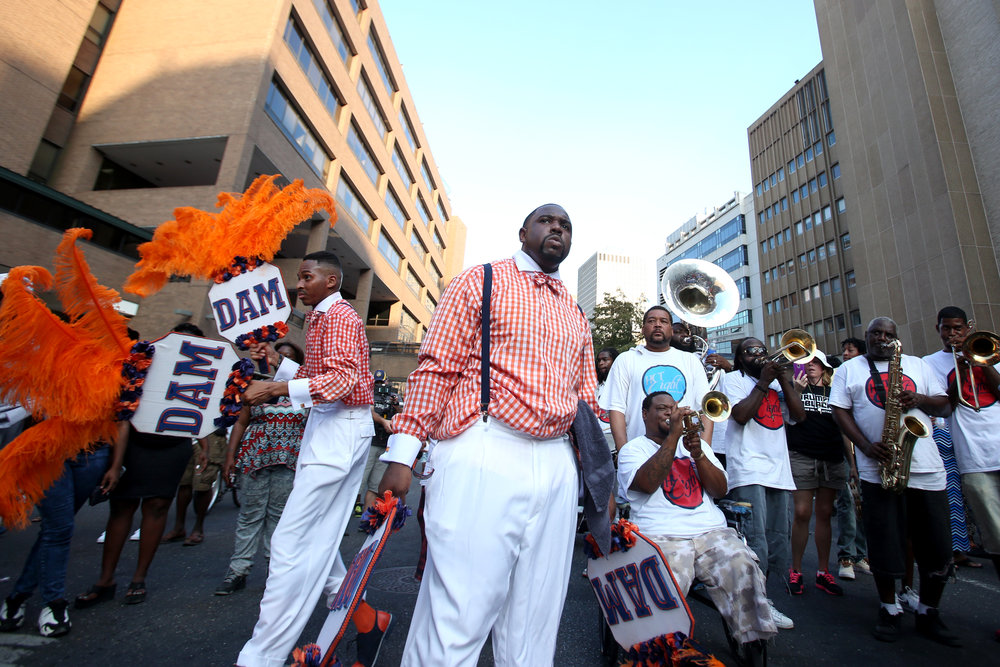 Members of the Dignified Achievable Men and Women Social Aid & Pleasure Club march from Loyola Avenue to the Smoothie King Center in New Orleans, Louisiana on Saturday, August 29, 2015. More than 15 community and cultural groups and bands participate in the Katrina 10 Commemorative Parade to honor the 10th anniversary of Hurricane Katrina.