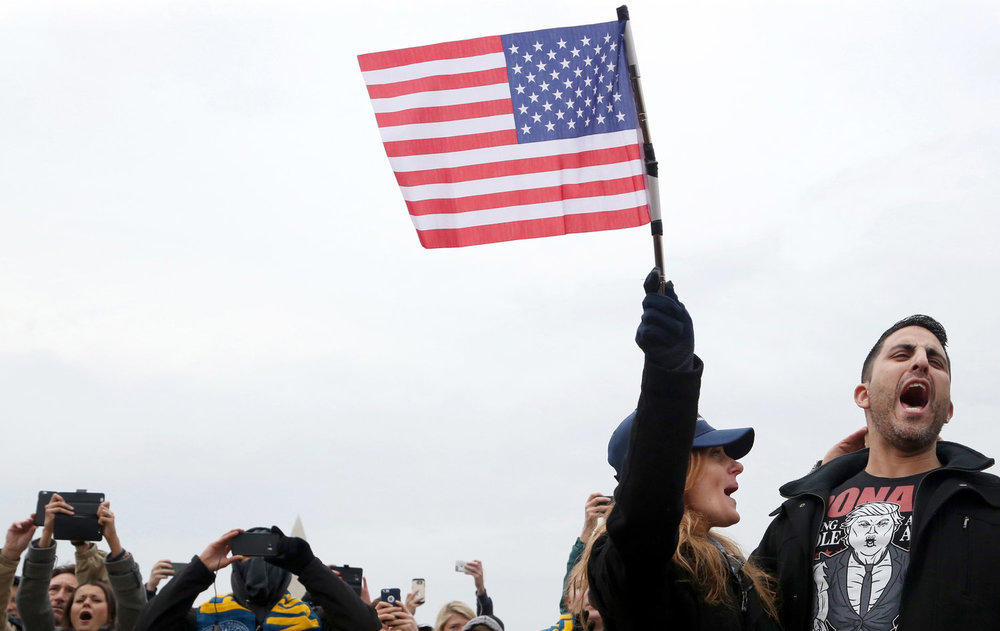 Spectators gather on the National Mall in Washington, D.C., Friday, January 20, 2017, to watch the inauguration of Donald Trump as the 45th President of the United States.