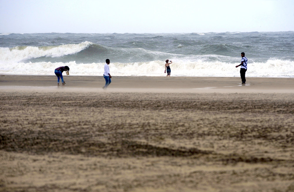 Vacationers take a trip to Ocean City, Maryland on Saturday, September 3, 2016, as Hermine downgraded to a post-tropical cyclone and brushed the resort town over Labor Day weekend.