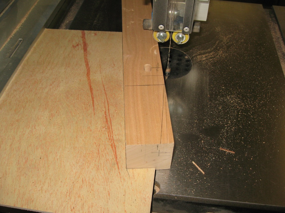 Quickie taper jig for the band saw; cut from a piece of scrap plywood (leftover drawer bottom stock)
