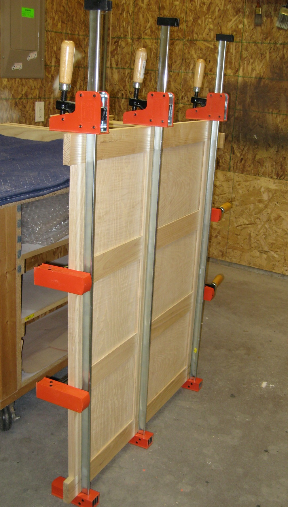 In the clamps; This is the panel that will be the back of the short bench.