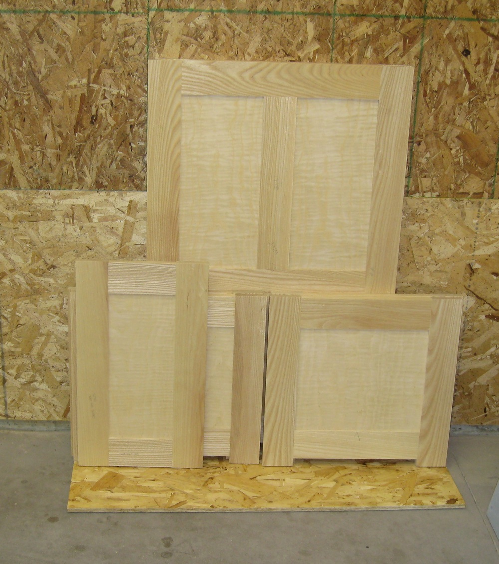 Bench part collection is building... Can you see the figure on those panels? Holy Cow that veneer is beautiful!