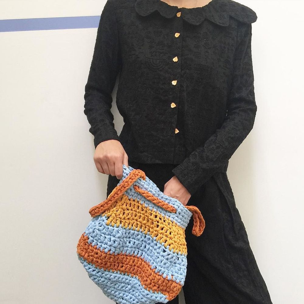 hand-embroidered warli on black raw silk + hand-knit cotton sacks