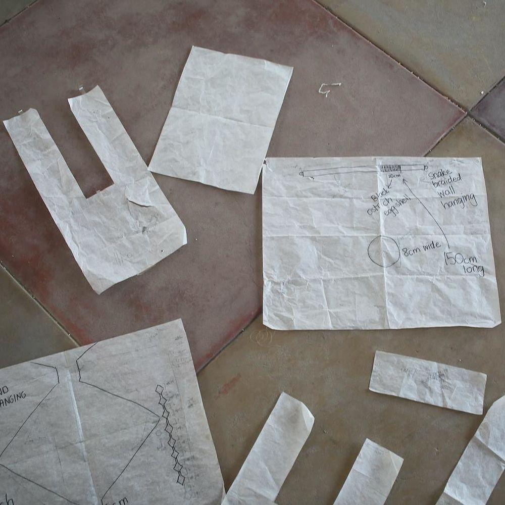 making paper patterns in Tsumkwe for our bead weaving workshop @meglawdon
