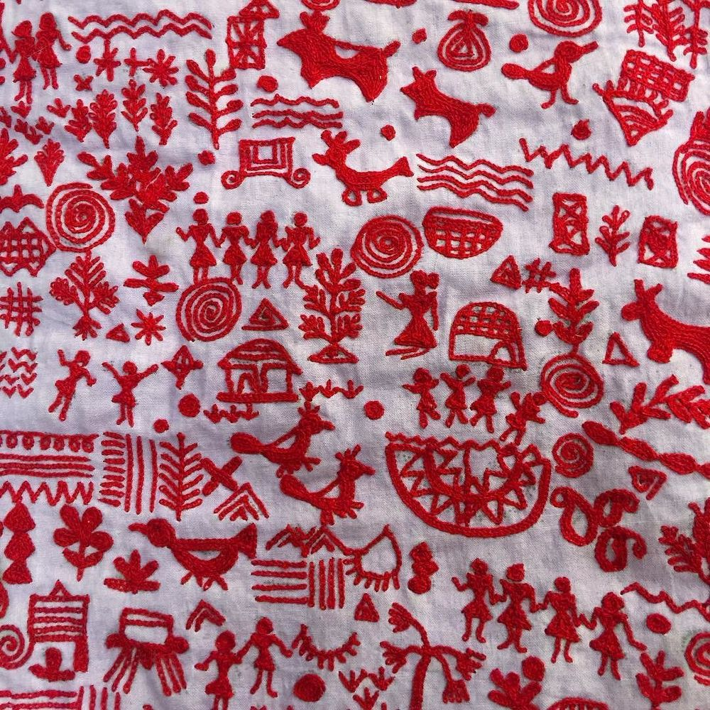red warli on lavender khadi // hand-embroidery from Ahmedabad