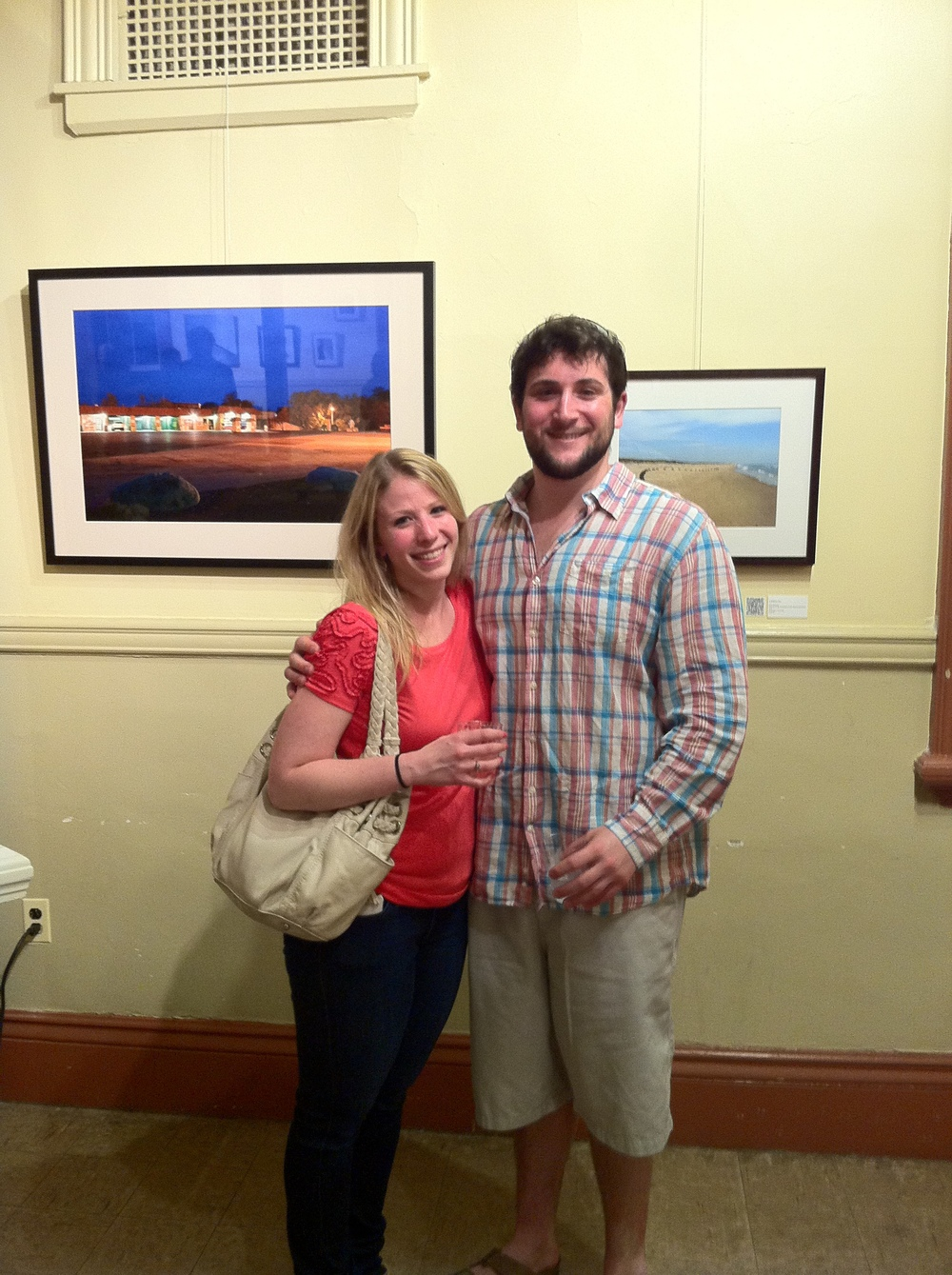 "My husband and I in front of ""Flatlands"" on display at the opening reception of ""Under the Influence"" at the Footlight Club in Jamaica Plain, MA"