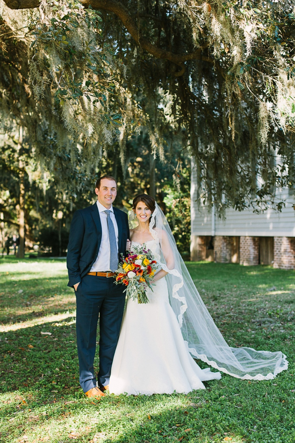 Lindsey_A_Miller_photography_charleston_mcleod_plantation_wedding_row_of_oaks_southern_classic_fall_spanish_moss_historic_home_040.jpg
