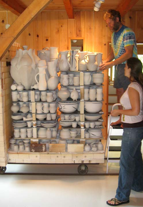 Deb and Peter loading the kiln