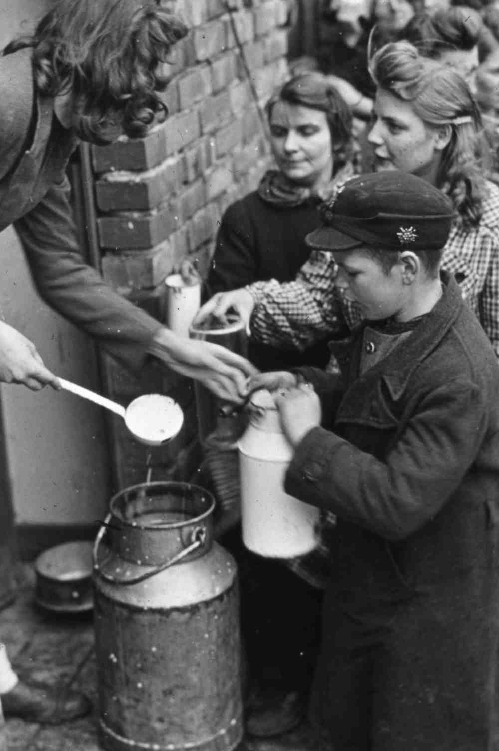 March 1945. Civilians stand in a milk line near Manheim, Germany.