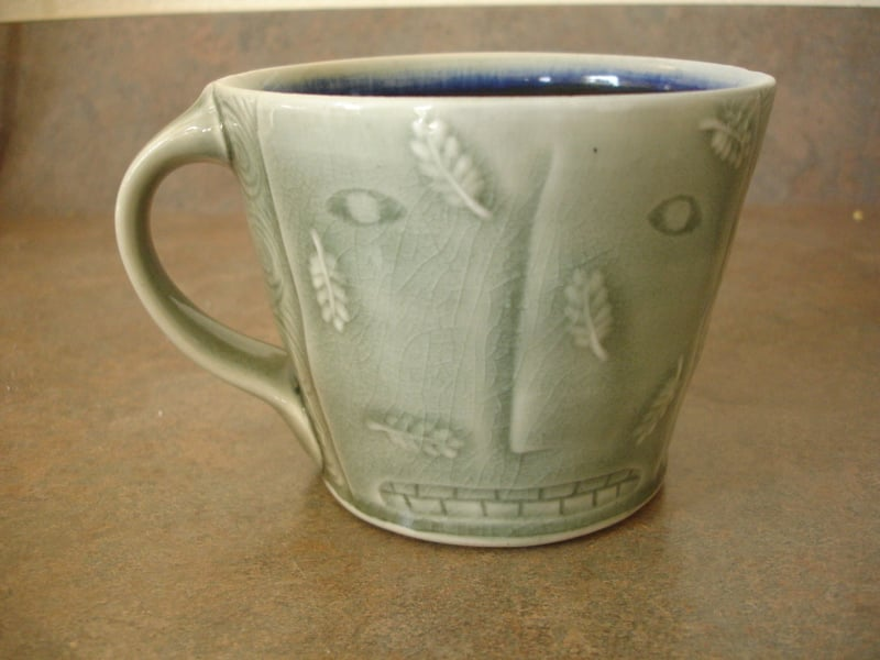 My first cup I ever bought!  A Matt Metz from the American Pottery Festival in Minneapolis at the Northern Clay Center in 1998.