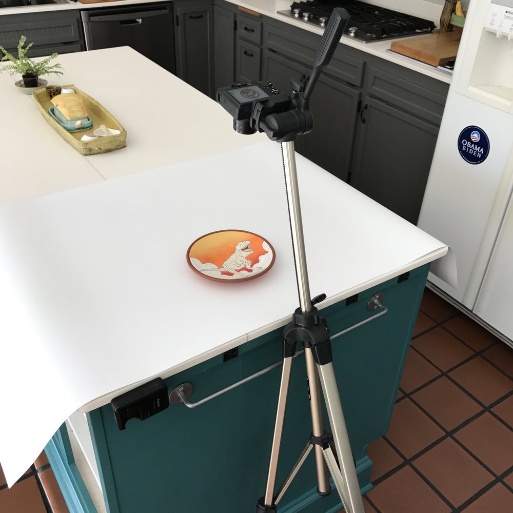 My dead simple kitchen set up - a backdrop, my tripod and camera + a little sun!  I often will even use my phone for taking photos.