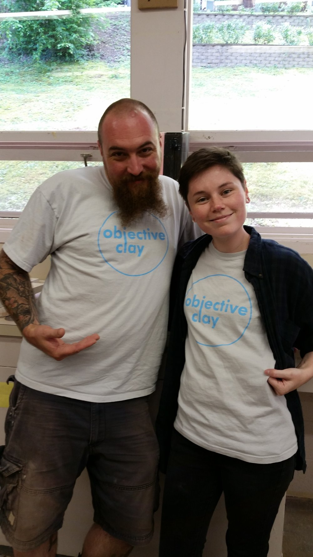 Student Candice Gooch-Ward and Blair Clemo showing off their Objective Clay T-shirts during a 2014 Summer Workshop at Arrowmont.